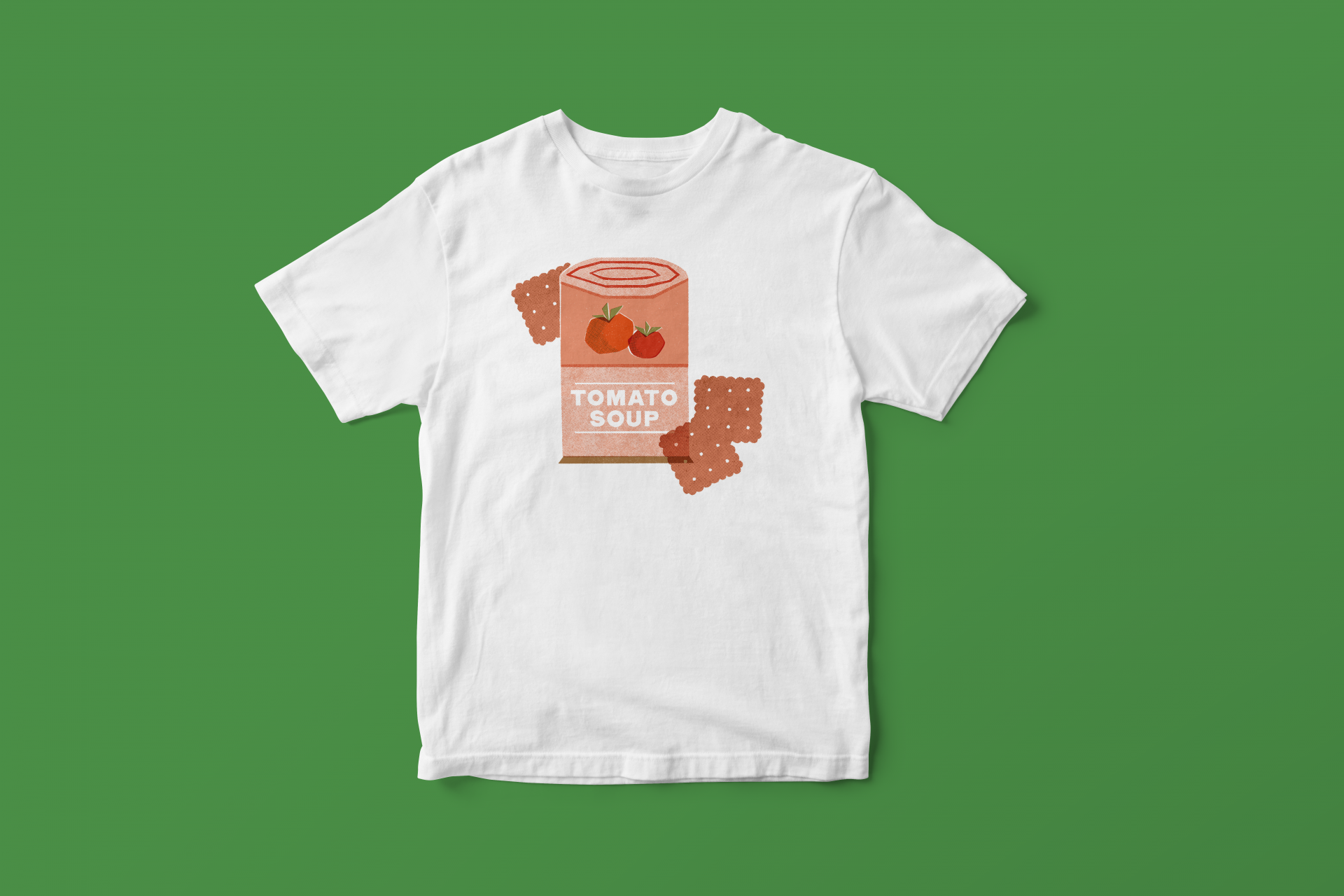 A white t-shirt with an illustration of tomato soup from the book, Alphabet Soup.