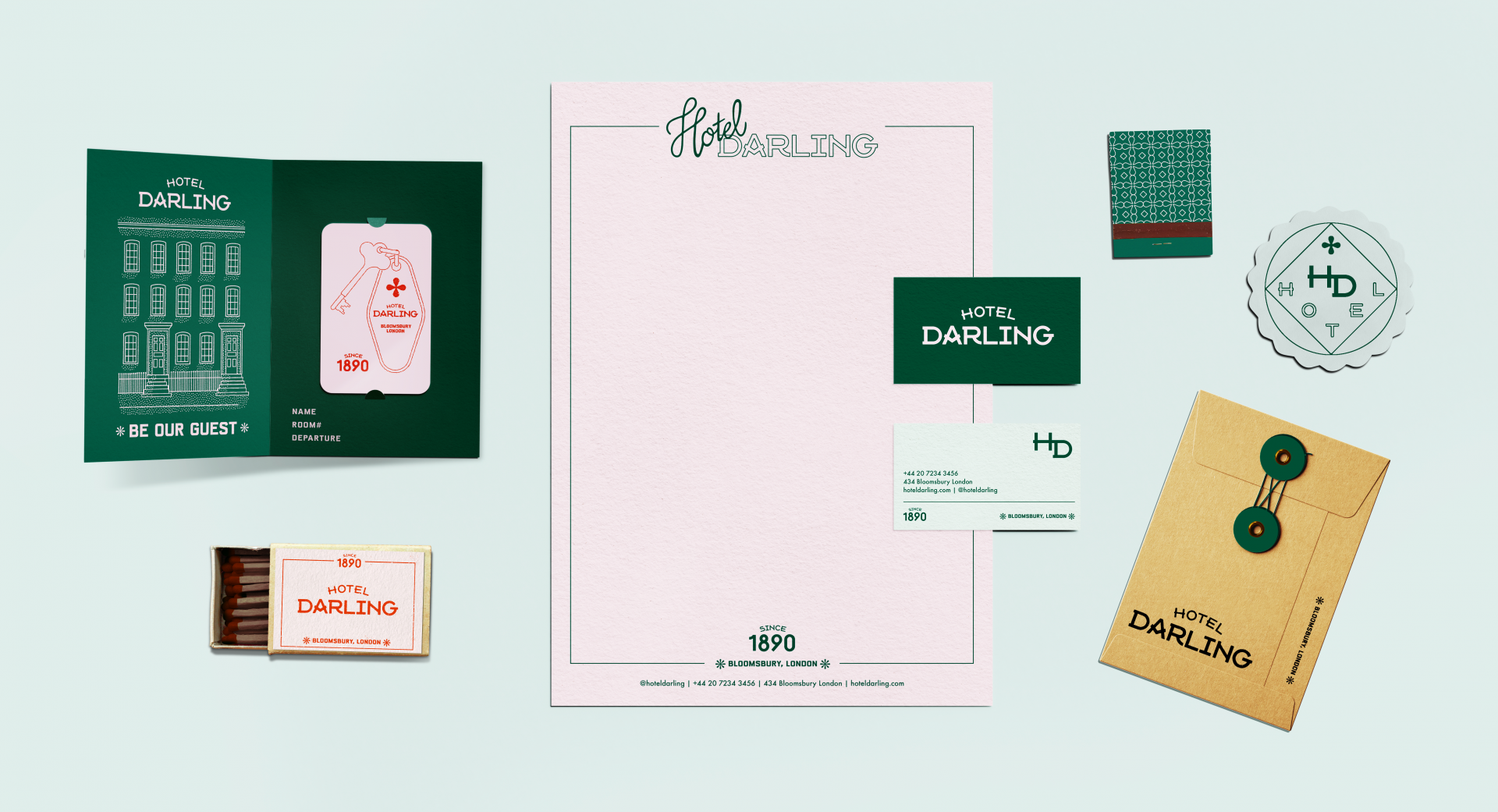 A photo of brand expressions of the fictional Hotel Darling, including stationery, a keycard, matches, a coaster and envelope.