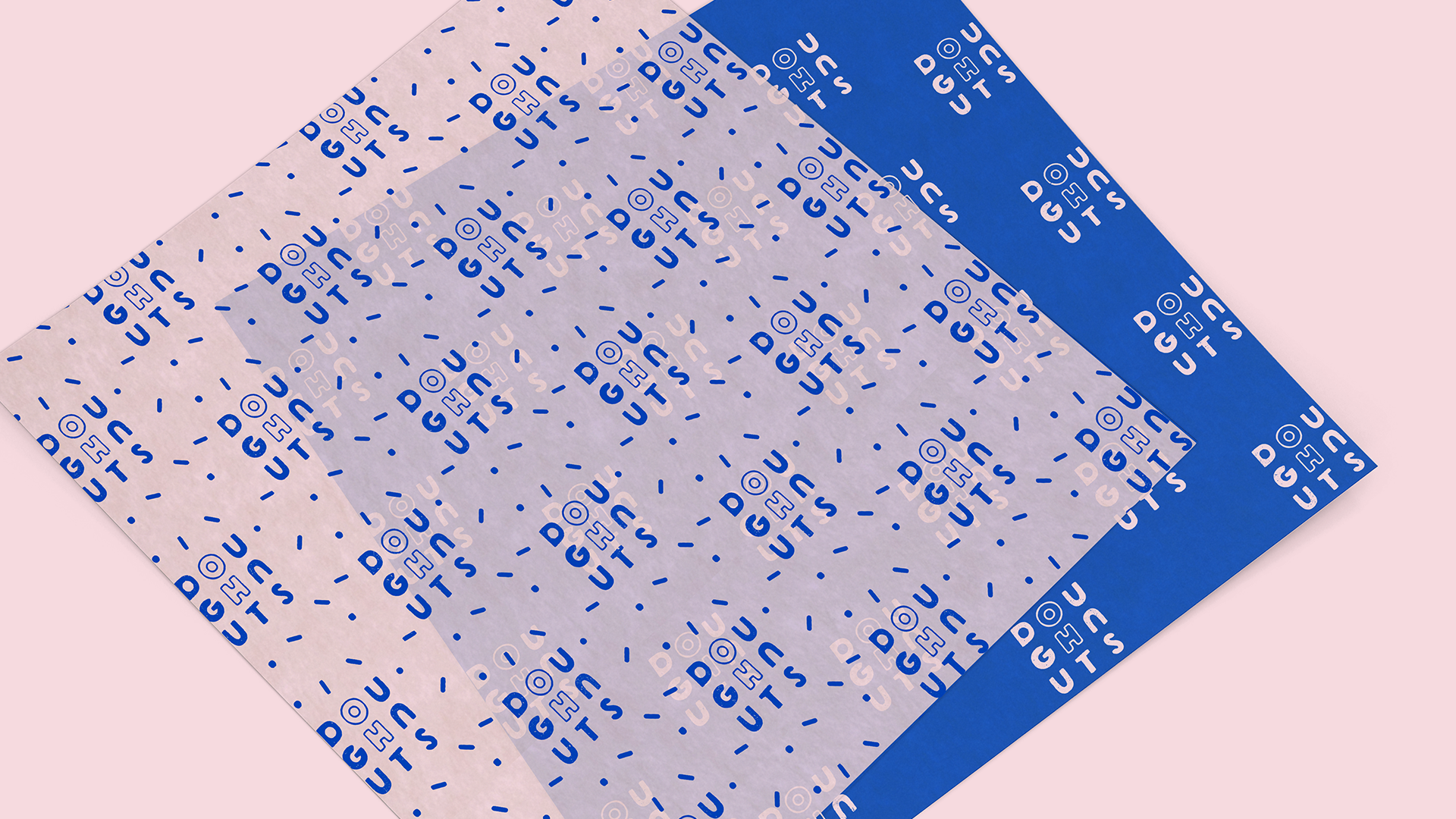 A mockup of bakery wax paper squares with a pattern, featuring the modular Oh Doughnuts logo and sprinkles.