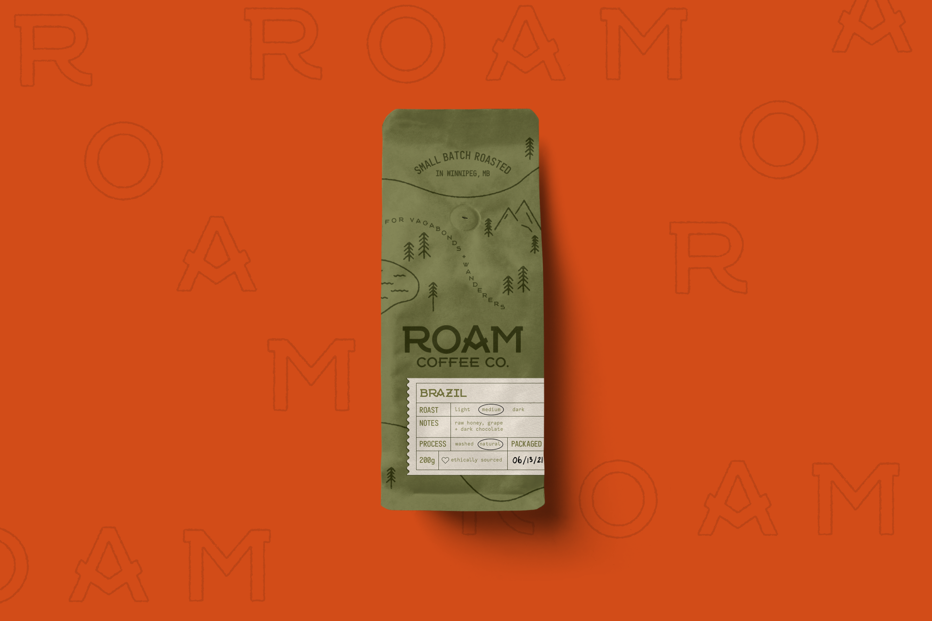 """An image of a bag of coffee from the fictional brand """"Roam Coffee Co."""" The coffee bag features"""